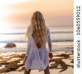 beautiful blonde girl with long ... | Shutterstock . vector #1060559012