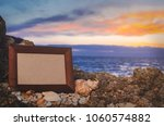 photo frame stone  sea at... | Shutterstock . vector #1060574882