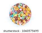 Stock photo bowl of mixed cereals chocolate corn flex honey rings and marshmallows on white background 1060575695