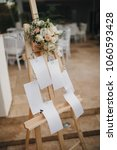board with guests seating cards ... | Shutterstock . vector #1060593428
