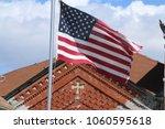 american flag waving near an... | Shutterstock . vector #1060595618
