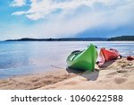 two kayaks moored on a sandy... | Shutterstock . vector #1060622588