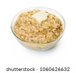 cooked oatmeal with butter on... | Shutterstock . vector #1060626632