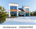 a modern house with large... | Shutterstock . vector #1060642982