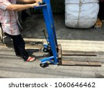 the men used forklifts are... | Shutterstock . vector #1060646462