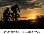 The Men Ride  Bikes At Sunset...
