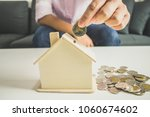 save money by saving the piggy... | Shutterstock . vector #1060674602