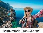 young woman traveler in... | Shutterstock . vector #1060686785