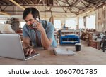 smiling young carpenter working ... | Shutterstock . vector #1060701785