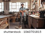 portrait of a young woodworker... | Shutterstock . vector #1060701815