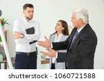 office employees having... | Shutterstock . vector #1060721588