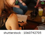 girl playing quiz night | Shutterstock . vector #1060742705