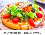 homemade vegetarian pizza with... | Shutterstock . vector #1060749962