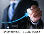 businessman pointing arrow...   Shutterstock . vector #1060760555