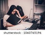asian woman working in office... | Shutterstock . vector #1060765196