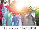 Stock photo rope with clean clothes outdoors on laundry day 1060777088