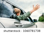 happy boy look out from auto... | Shutterstock . vector #1060781738
