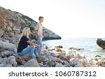 mother and son visiting rocky... | Shutterstock . vector #1060787312