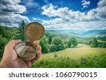 compass in the hand against... | Shutterstock . vector #1060790015
