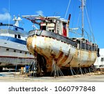 a large iron rusting ship is in ... | Shutterstock . vector #1060797848
