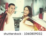 happy young couple with bags in ... | Shutterstock . vector #1060809032