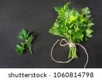 fresh green parsley in bunch on ... | Shutterstock . vector #1060814798