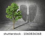 eco concept. green tree cast... | Shutterstock . vector #1060836368