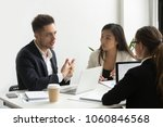serious concentrated coworkers... | Shutterstock . vector #1060846568