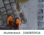mans legs next to puddle. rainy ... | Shutterstock . vector #1060850426