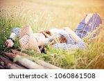 beautiful young woman laying on ... | Shutterstock . vector #1060861508