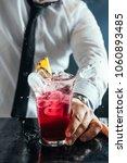bartender preparing red... | Shutterstock . vector #1060893485