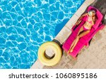 woman relaxing on chaise lounge ... | Shutterstock . vector #1060895186