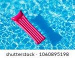 pink inflatable mattress... | Shutterstock . vector #1060895198