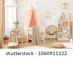 white bookcase with plush toys... | Shutterstock . vector #1060911122
