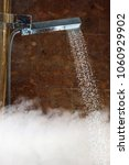 Small photo of shower douche with water stream and hot steam