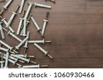 new dowels on the wooden table... | Shutterstock . vector #1060930466