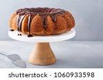 vanilla bundt cake with... | Shutterstock . vector #1060933598