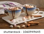cups of hot chocolate drink... | Shutterstock . vector #1060949645