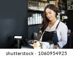 asian women barista smiling and ... | Shutterstock . vector #1060954925