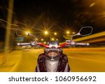 the view over the handlebars of ...   Shutterstock . vector #1060956692