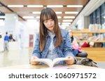 beautiful asian women read... | Shutterstock . vector #1060971572
