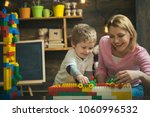 mother and happy son play with...   Shutterstock . vector #1060996532
