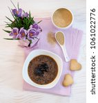 Small photo of flowers , cookies and porridge of amaranth with prunes