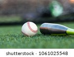 cloase up of a baseball and a... | Shutterstock . vector #1061025548