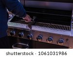 cleaning bbq grill for grilling ... | Shutterstock . vector #1061031986