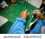 soldering electronic parts on... | Shutterstock . vector #1061035235