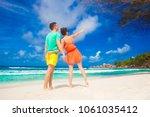young happy family having fun... | Shutterstock . vector #1061035412