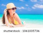 woman in bikini and straw hat... | Shutterstock . vector #1061035736