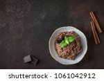 chocolate rice pudding with... | Shutterstock . vector #1061042912