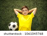 happy teenage boy with a soccer ... | Shutterstock . vector #1061045768